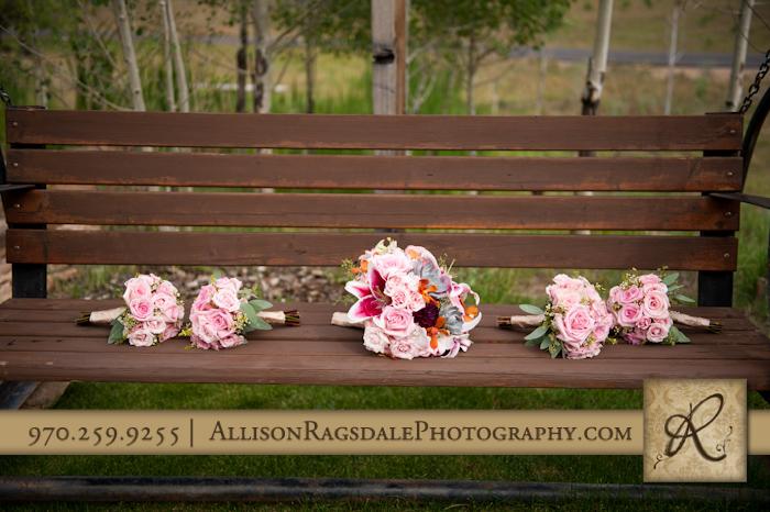 flowers on swinging bench at thunder ridge from wedding party durango co