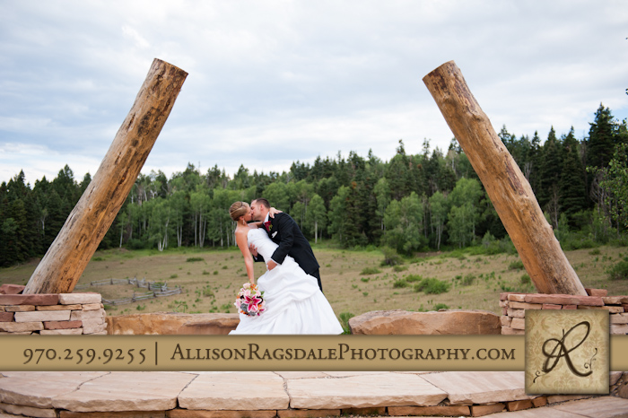 bride and groom kissing at ceremony site at thunder ridge durango co