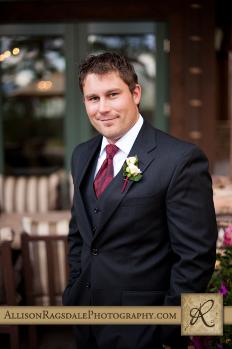 portrait of groom on wedding day in durango colorado at the glacier club