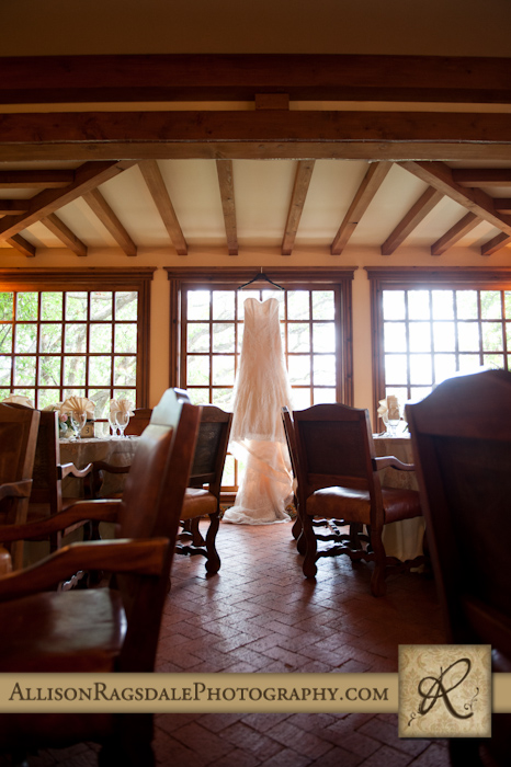 wedding dress hanging in dining room at blue lake ranch