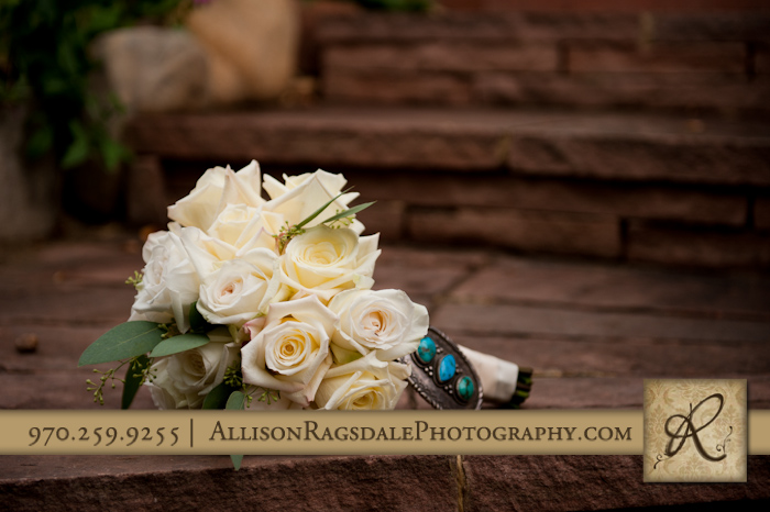 bridal bouquet on stairs at blue lake ranch durango co
