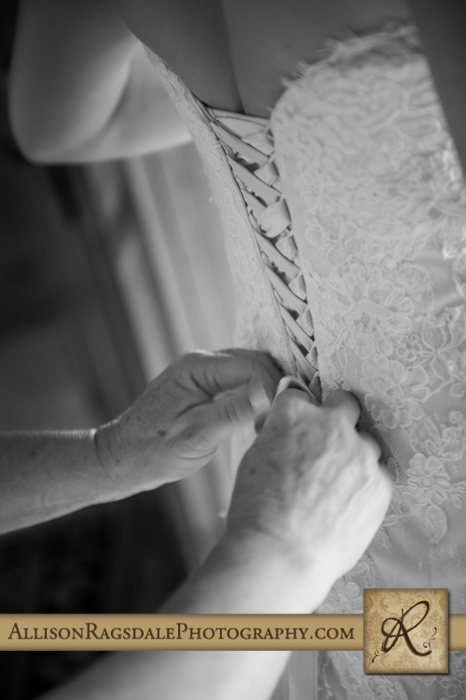 mother dressing daughter/bride in wedding dress at blue lake ranch