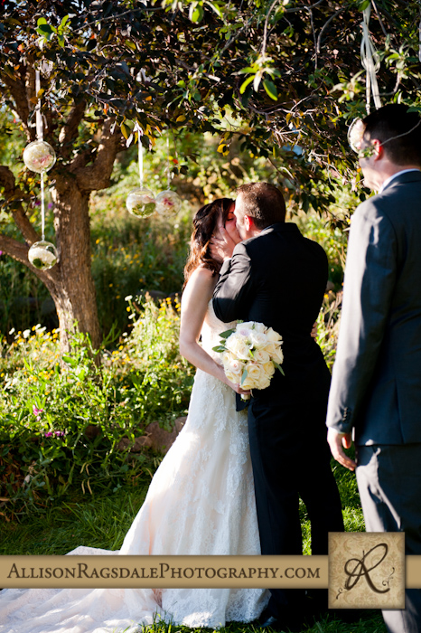 bride and groom first kiss wedding ceremony blue lake ranch durango co
