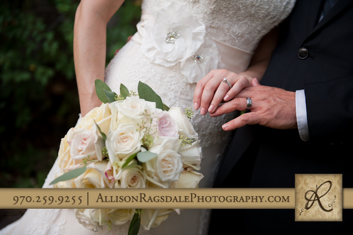 brides bouquet and newlywed rings at blue lake ranch durango co