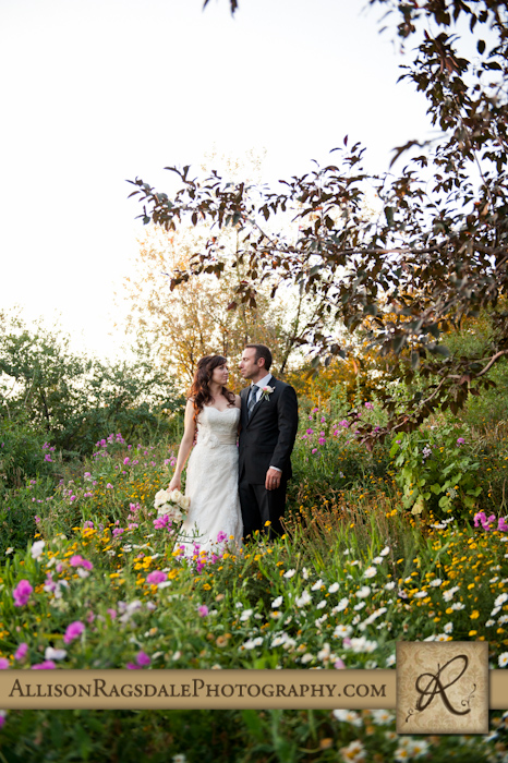 bride and groom in flowers at blue lake ranch hesperus co