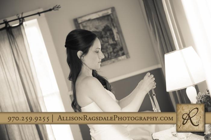 bride getting ready for wedding kendall mountain silverton wedding