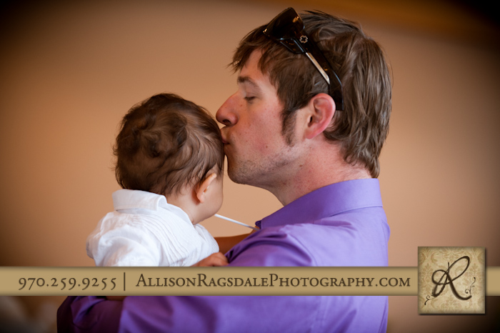 father kissing baby son wedding reception kendall mountain silverton co