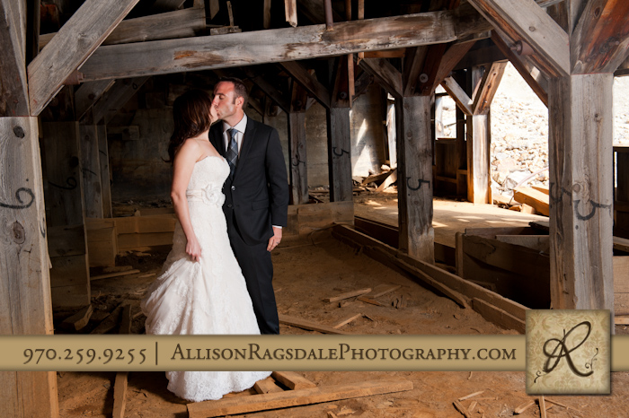 bride and groom in old mining structure animas forks colorado