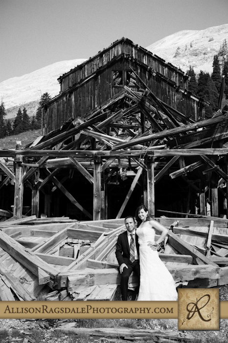 bride and groom in front of ghost town animas forks