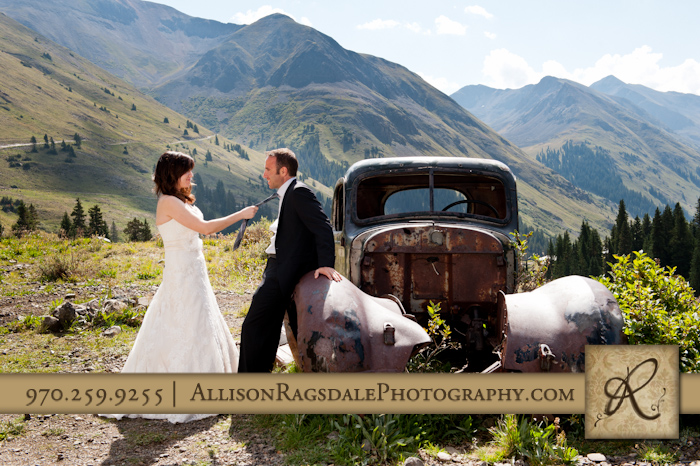 bride pulling groom's tie in animas forks silverton