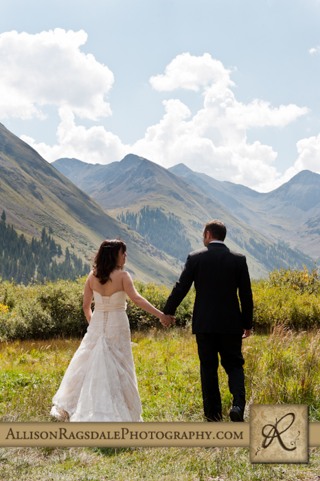 bride and groom walking away in silverton mountains colorado