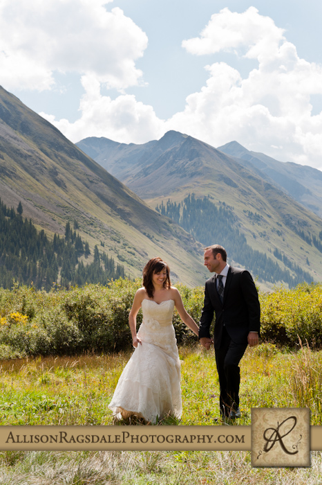 bride and groom walking in silverton mountains animas forks