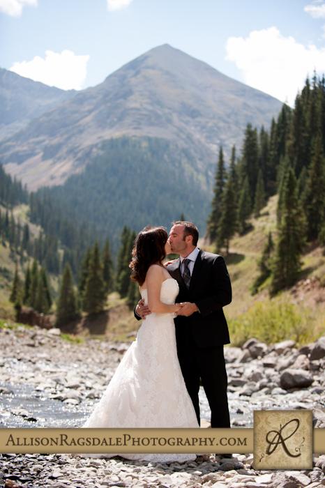 bride and groom along river silverton colorado