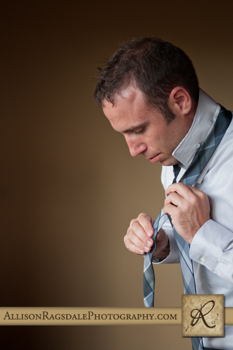 groom tying tie for wedding ceremony at blue lake ranch durango co