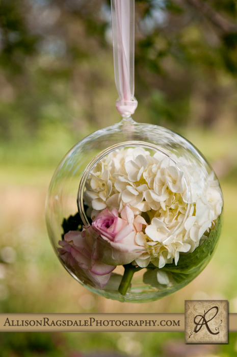 flowers in globes wedding ceremony durango blue lake ranch