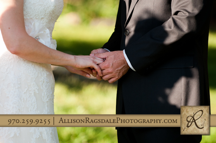 bride and groom holding hands during wedding ceremony at blue lake ranch
