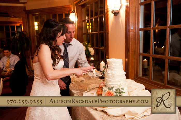 bride and groom cutting cake for wedding reception at blue lake ranch