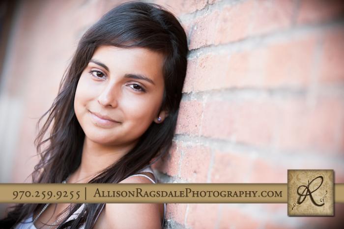 Girl senior photo on brick wall