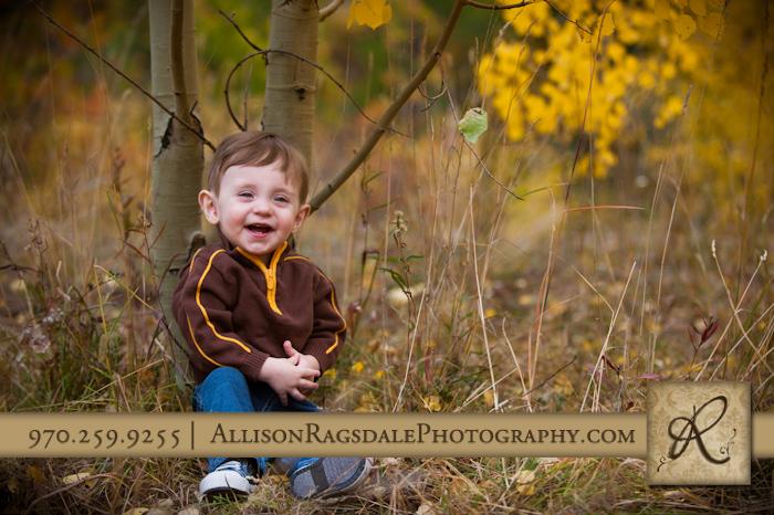 little boy in fall colors aspen trees durango colorado
