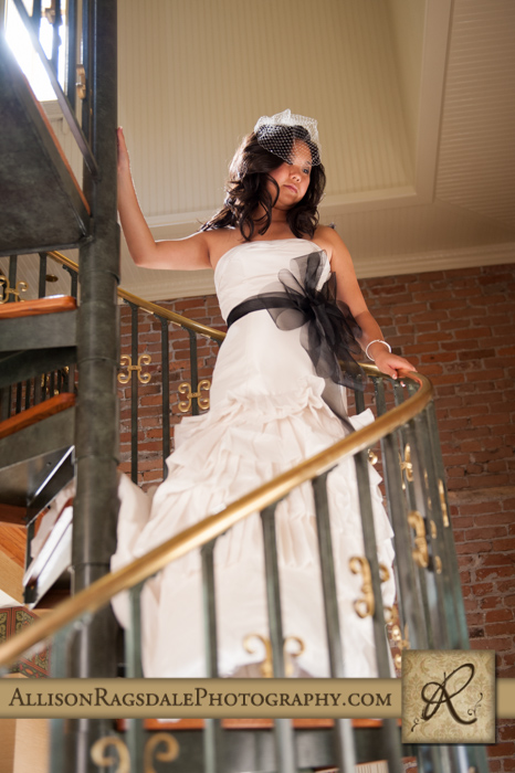 bride on spiral staircase beaumont hotel ouray co wedding photo