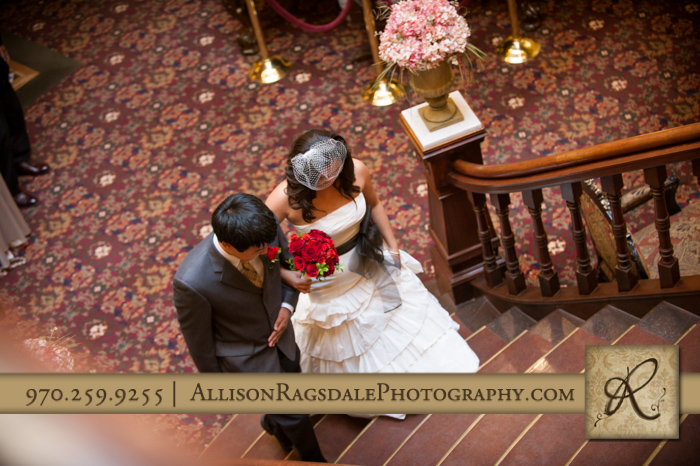 "brother walking bride/sister ""down aisle"" up staircase beaumont hotel ouray co wedding photo"