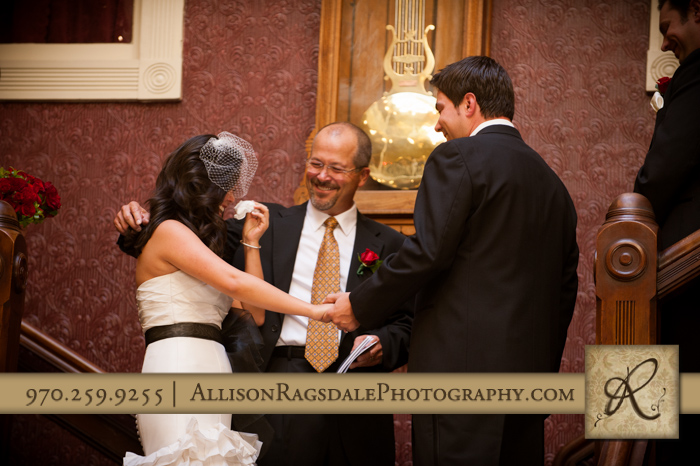 father/officiant comforting daughter/bride beaumont hotel ouray co wedding photo
