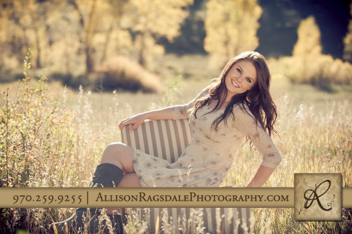 senior girl picture in long grass on chair in field durango co