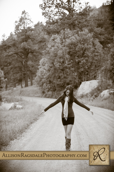 black and white walking down dirt road girl senior pic