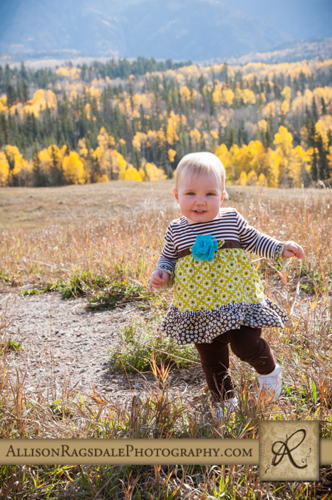 baby girl walking through field durango colorado picture