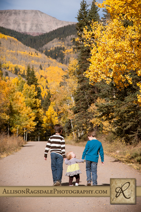 brothers and sister walking down road fall colors durango