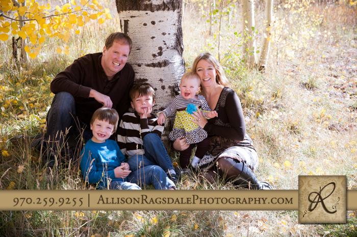 family portrait aspen tree trunks in fall in durango co