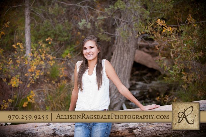 Girl on log senior pic in Durango