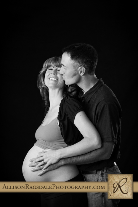dad kissing mom maternity studio portrait durango co
