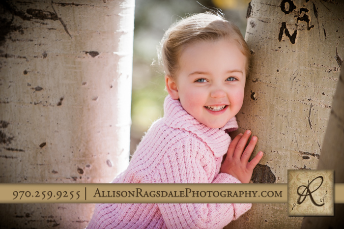 little girl hugging aspen tree picture in the park durango fall co
