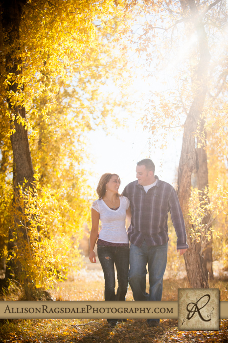 engagement picture walking in fall leaves mancos co