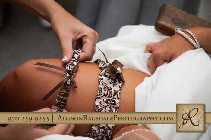 bride putting on garters for wedding mancos colorado