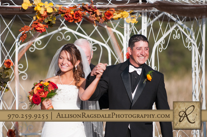 bride and groom celebrate being newlyweds ceremony mancos co