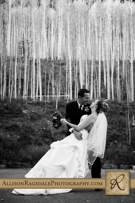 bride and groom kissing below aspen tree grove black and white silverpick lodge durango co