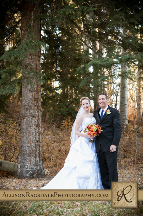 bride and groom in pine trees silverpick lodge durango co