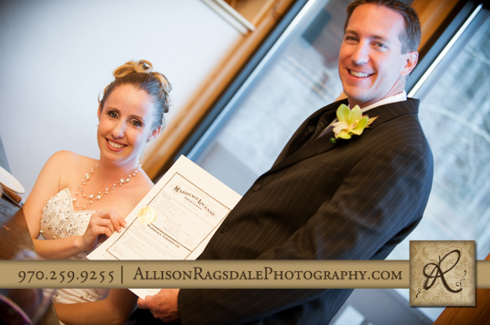 bride and groom with marriage certificate durango co