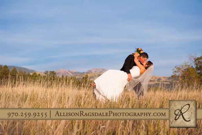 bride and groom kiss dip in field mancos colorado