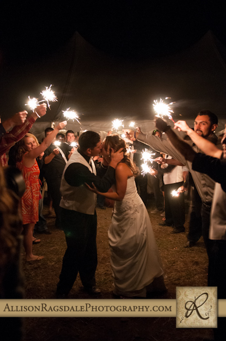 bride and groom kiss in middle of sparkler exit wedding reception mancos co