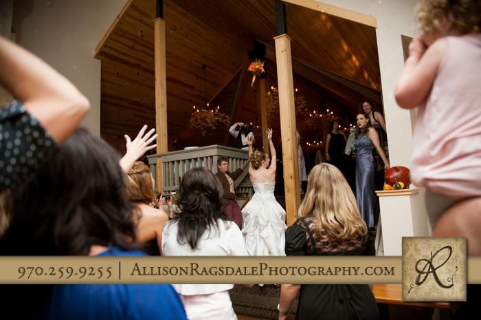 bride bouquet toss reception at silverpick lodge durango co