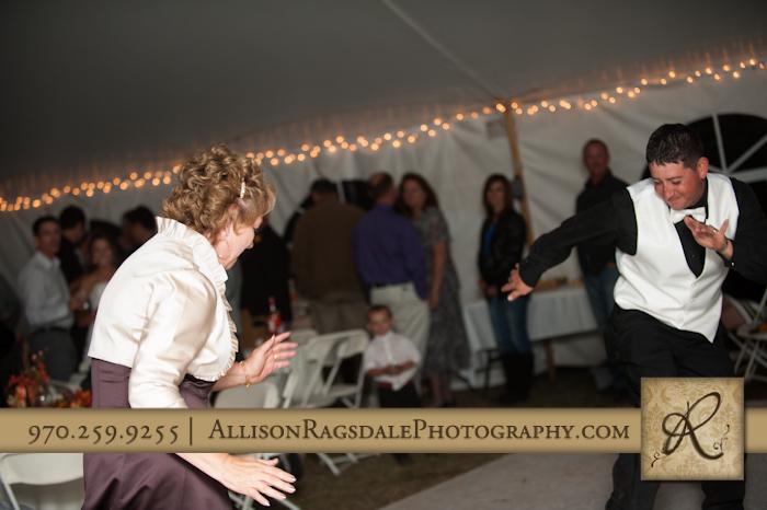 groom and mother of groom dancing wedding reception