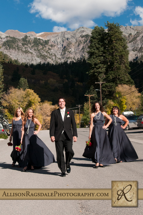 groom and bridesmaid walking down streets in ouray beaumont hotel ouray co wedding photo