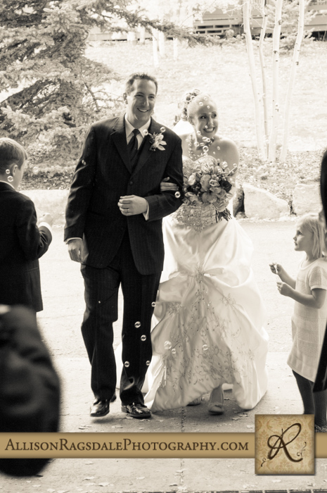 bride and groom entering reception with bubbles at silverpick lodge durango co