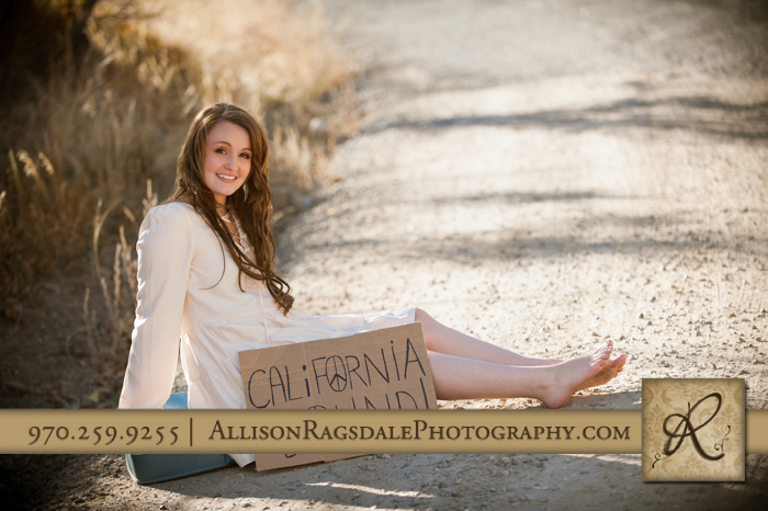 blue vintage suitcase and cardboard sign senior picture durango co