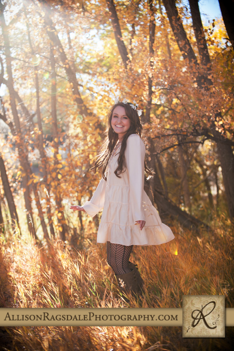 senior girl picture twirling in the fall leaves durango co