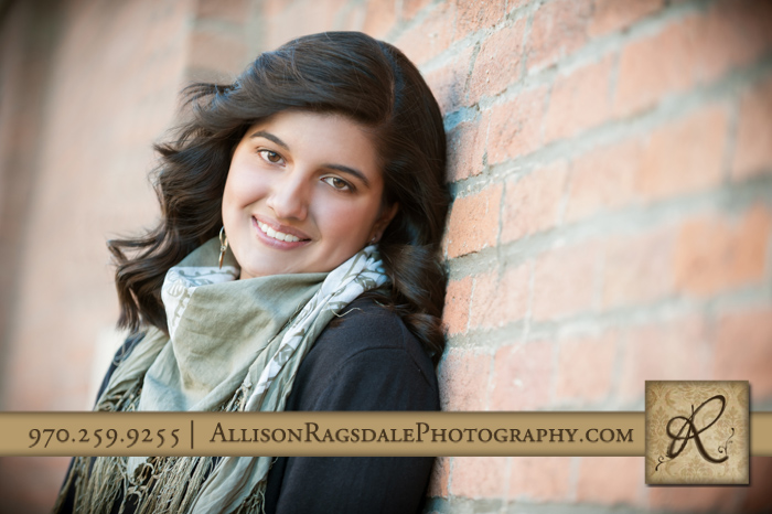 senior girl pic on brick wall downtown durango co