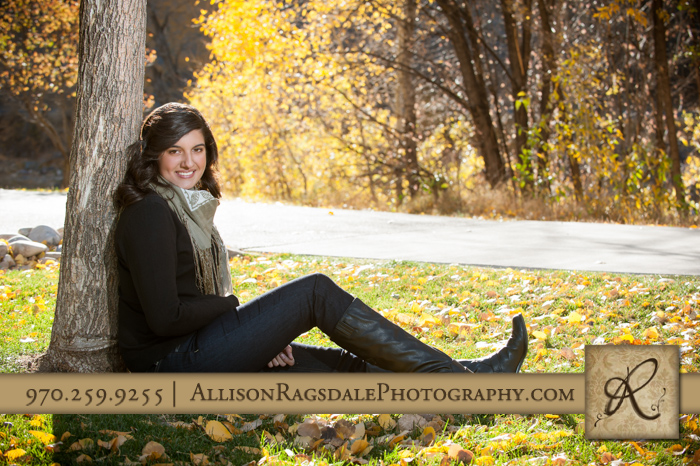 senior photo fall colors leaning on tree durango co